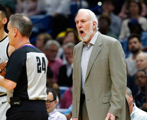 (AP Photo/Scott Threlkeld). San Antonio Spurs head coach Gregg Popovich disputes a call with referee Mike Callahan (24) in the first half of an NBA basketball game against the New Orleans Pelicans in New Orleans, Wednesday, April 11, 2018.
