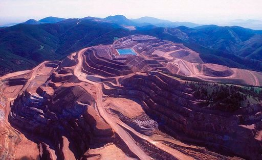"""(Larry Mayer/Billings Gazette via AP, File). FILE - This 1998 file photo shows the now-defunct Zortman-Landusky mine in the Little Rocky Mountains. An Idaho mining company is asking a Montana judge to strike down its designation as a """"bad actor"""" over p..."""
