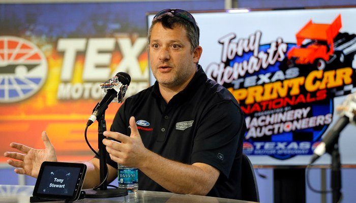 Tony Stewart responds to reporters during a news conference at Texas Motor Speedway in Fort Worth, Texas, Friday, April 7, 2017. (AP Photo/Tony Gutierrez)