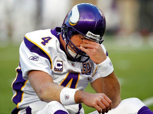 (AP Photo/Winslow Townson, File). FILE - In this Oct. 31, 2010, file photo, Minnesota Vikings quarterback Brett Favre rubs his eyes after being hit by New England Patriots linebacker Gary Guyton during the first quarter of an NFL football game in Foxbo...