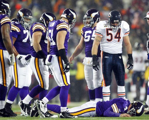 (AP Photo/Andy King, File). FILE - In this Dec. 20, 2010, file photo, Chicago Bears' Brian Urlacher (54) looks down as Minnesota Vikings quarterback Brett Favre (4) lies on the ground after being hit during the first half an NFL football game in Minnea...