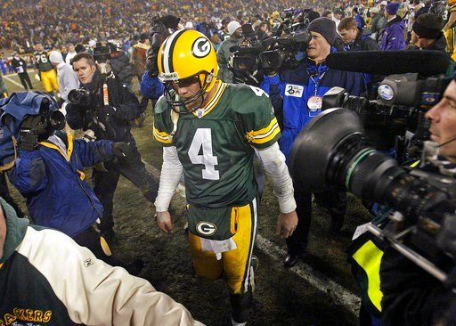 (AP Photo/Darren Hauck, File). FILE - In this Jan. 9, 2005, file phoot,  Green Bay Packers quarterback Brett Favre holds his head down as he walks off the field following the NFC wild-card game against the Minnesota Vikings in Green Bay, Wis. Favre say...
