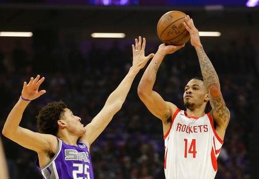 (AP Photo/Rich Pedroncelli). Houston Rockets guard Gerald Green, right, shoots over Sacramento Kings forward Justin Jackson during the first quarter of an NBA basketball game, Wednesday, April 11, 2018, in Sacramento, Calif.
