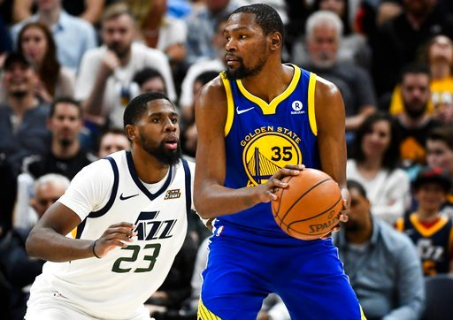 (AP Photo/Alex Goodlett). Utah Jazz forward Royce O'Neale (23) guards Golden State Warriors forward Kevin Durant (35) in the second half of an NBA basketball game Tuesday, April 10, 2018, in Salt Lake City.