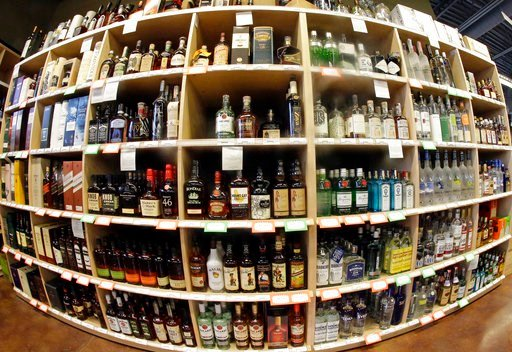 (AP Photo/Rick Bowmer, File). FILE - This June 16, 2016 file photo made with a fisheye lens shows bottles of alcohol during a tour of a state liquor store in Salt Lake City. A large international study released on Thursday, April 12, 2018 says adults s...