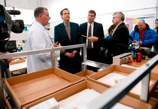 (AP Photo/Ruth Bonneville, File). FILE - In this Nov. 12, 2003, file photo, CanadaDrugs.com Director of Pharmacy Robert Fraser, left, takes Minnesota Gov. Tim Pawlenty, second left, on a tour of the Internet pharmacy CanadaDrugs.com in Winnipeg, Manito...