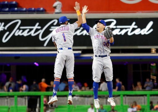 (AP Photo/Lynne Sladky). New York Mets' Amed Rosario (1) and Michael Conforto (30) celebrate after the Mets defeated the Marlins 4-1 during a baseball game, Wednesday, April 11, 2018, in Miami.
