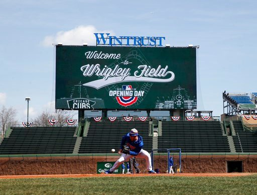 (AP Photo/Jim Young). Chicago Cubs' Ian Happ takes part in a warm-up prior to the start of the Cubs' home opening baseball game against the Pittsburgh Pirates at Wrigley Field Tuesday, April 10, 2018, in Chicago.