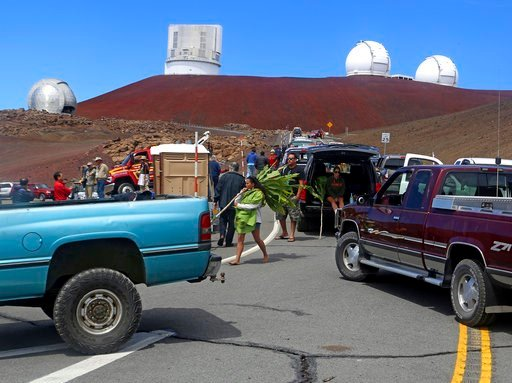 (Hollyn Johnson/Hawaii Tribune-Herald via AP). FILE - In this Oct. 7, 2014 photo, protesters block vehicles from getting to the Thirty Meter Telescope groundbreaking ceremony site at Mauna Kea, Hawaii. On Friday, April 13, 2018, officials with the obse...
