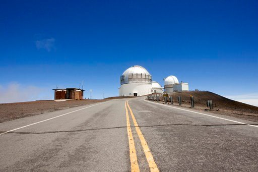 (AP Photo/Caleb Jones, File). FILE - In this Aug. 31, 2015 file photo, telescopes are shown on Mauna Kea, Hawaii's tallest mountain and the proposed construction site for a new $1.4 billion telescope, near Hilo, Hawaii. On Friday, April 13, 2018, offic...