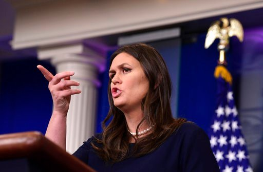 (AP Photo/Susan Walsh). White House press secretary Sarah Huckabee Sanders speaks during the daily briefing at the White House in Washington, Friday, April 13, 2018. Sanders was asked about Syria, former FBI Director James Comey, and other topics.
