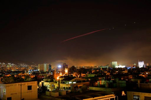 (AP Photo/Hassan Ammar). Explosions lit up the skies with anti-aircraft fire, over Damascus, the Syrian capital, as the U.S. launches an attack on Syria targeting different parts of the Syrian capital Damascus, Syria, early Saturday, April 14, 2018. Sy...
