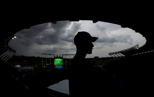 (AP Photo/Charlie Riedel). Zack Hample, from New York, watches storm clouds from the upper deck at Kauffman Stadium before a baseball game between the Kansas City Royals and the Los Angeles Angels, Friday, April 13, 2018, in Kansas City, Mo.