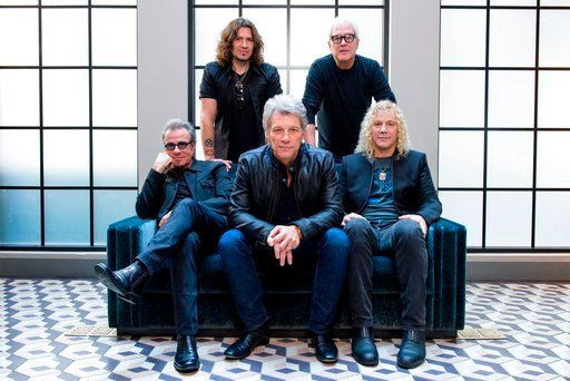 (Photo by Drew Gurian/Invision/AP, File). FILE - In this Oct. 19, 2016 file photo, members of Bon Jovi front row from left, Tico Torres, Jon Bon Jovi, David Bryan, back row from left, Phil X, and Hugh McDonald pose for a portrait in promotion of their ...