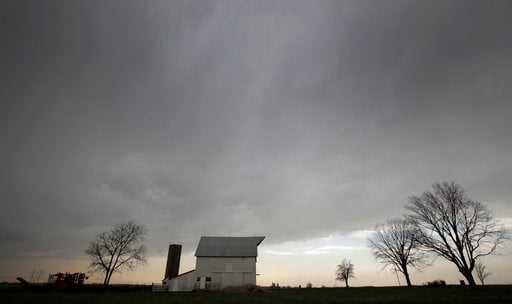 (AP Photo/Orlin Wagner). A line of thunderstorms pass over a barn near Baldwin City, Kan., Friday, April 13, 2018. The area was under a severe thunderstorm warning.