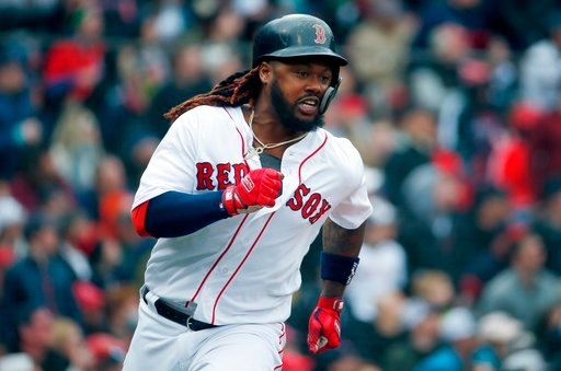 (AP Photo/Michael Dwyer). Boston Red Sox's Hanley Ramirez runs on his two-run double during the fourth inning of a baseball game against the Baltimore Orioles in Boston, Saturday, April 14, 2018.