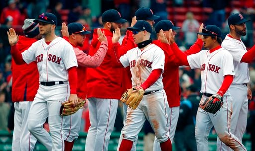 (AP Photo/Michael Dwyer). Boston Red Sox players, from left foreground, Andrew Benintendi, Brock Holt and Tzu-Wei Lin celebrate after defeating the Baltimore Orioles in a baseball game in Boston, Saturday, April 14, 2018.