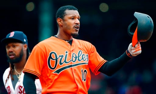 (AP Photo/Michael Dwyer). Baltimore Orioles' Adam Jones (10) reacts after grounding into a double play during the eighth inning of a baseball game against the Boston Red Sox in Boston, Saturday, April 14, 2018.