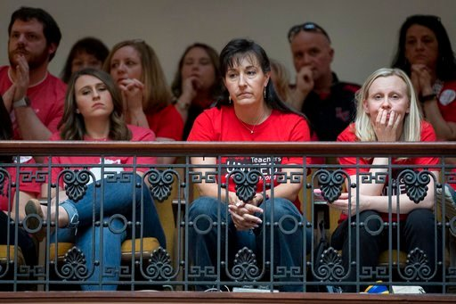(AP Photo/Bryan Woolston). Teachers look on as The Senate votes on bills for increased funding and to changes to their state funded pension system, Friday, April 13, 2018, in Frankfort, Ky.