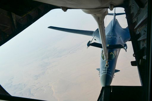 (Department of Defense via AP). In this image released by the Department of Defense, a U.S. Air Force B-1 Bomber separates from the boom pod after receiving fuel from an Air Force KC-135 Stratotanker on April 13, 2018.