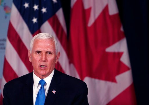 (AP Photo/Karel Navarro). U.S. Vice President Mike Pence speaks during a bilateral meeting with Canada's Prime Minister Justin Trudeau, at the Summit of the Americas in Lima, Peru, Saturday, April 14, 2018.