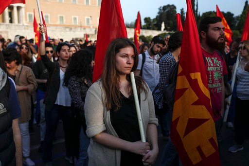 (AP Photo/Yorgos Karahalis). Supporters of the Greek Communist party take part in an anti-war rally in front of the parliament, in Athens, Saturday, April 14, 2018. Thousands of supporters of the party marched to the U.S. embassy opposing the military ...