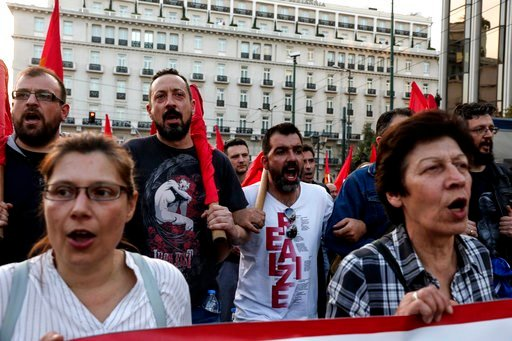 (AP Photo/Yorgos Karahalis). Supporters of the Greek Communist party chant slogans during an anti-war rally in front of the parliament, in Athens, Saturday, April 14, 2018. Thousands of supporters of the party marched to the U.S. embassy opposing the m...