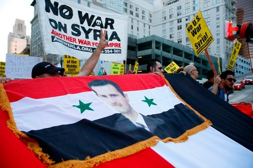 (AP Photo/Damian Dovarganes). Syrian-Americans express their anger at the missile strikes on their homeland during an anti-war rally opposing the military strikes by Western countries in Syria, in downtown Los Angeles, Saturday, April 14, 2018.