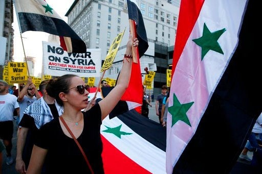 (AP Photo/Damian Dovarganes). Syrian-Americans express their anger at the missile strikes on their homeland during an anti-war rally opposing the military strikes by Western countries in Syria, in downtown Los Angeles, Saturday, April 14, 2018. On Satu...