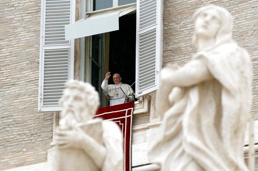 (AP Photo/Gregorio Borgia). Pope Francis delivers a blessing during the Regina Coeli noon prayer he delivered from his studio window overlooking St. Peter's Square, at the Vatican, Sunday, April 15, 2018.
