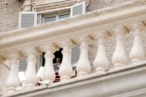 (AP Photo/Gregorio Borgia). Pope Francis delivers his message during the Regina Coeli noon prayer he delivered from his studio window overlooking St. Peter's Square, at the Vatican, Sunday, April 15, 2018.