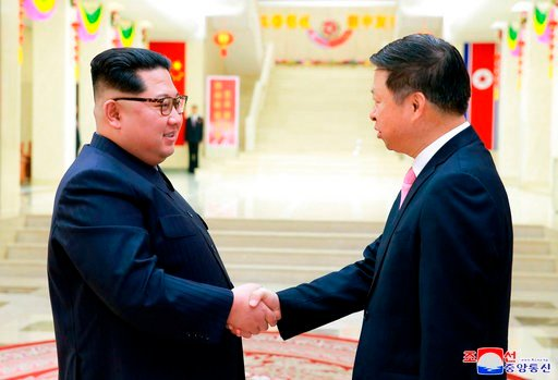 (Korean Central News Agency/Korea News Service via AP). In this April 14, 2018, photo provided Sunday, April 15, 2018, by the North Korean government, North Korean leader Kim Jong Un, left, shakes hands with Song Tao, head of the Chinese Communist Part...