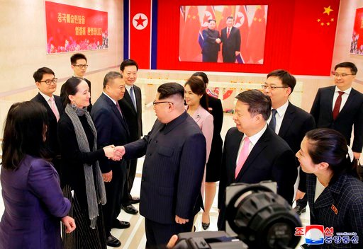 (Korean Central News Agency/Korea News Service via AP). In this April 14, 2018, photo provided Sunday, April 15, 2018, by the North Korean government, North Korean leader Kim Jong Un, center, greets the members of Chinese art troupe, as Song Tao, cente...