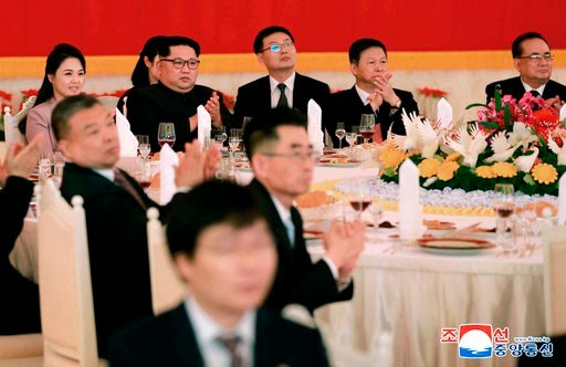 (Korean Central News Agency/Korea News Service via AP). In this April 14, 2018, photo provided Sunday, April 15, 2018, by the North Korean government, North Korean leader Kim Jong Un, second from left in rear,  and Song Tao, second from right, head of ...