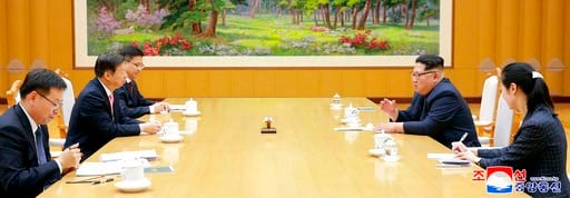 (Korean Central News Agency/Korea News Service via AP). In this April 14, 2018, photo provided Sunday, April 15, 2018, by the North Korean government, North Korean leader Kim Jong Un, second from right, talks with Song Tao, second from left, head of th...