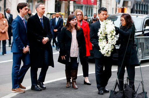 (AP Photo/Michael Dwyer). The father of Lingzi Lu, Jun Lu, second from right, and her aunt Helen Zhao, right, place a wreath as the family of Martin Richard, from left, Henry, Bill, Jane and Denise look on during a ceremony at the site where Martin Ric...