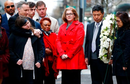 (AP Photo/Michael Dwyer). The father of Lingzi Lu, Jun Lu, second from right, and her aunt Helen Zhao, right, observe a moment of silence with the family of Martin Richard, foreground from left, Bill, Jane, Henry and Denise, center, during a ceremony a...