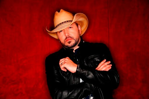 "(AP Photo/Mark Humphrey, File). FILE - In this March 19, 2018, photo, country music singer Jason Aldean poses in Nashville, Tenn., to promote his eighth studio album ""Rearview Town."" Aldean will perform at the the Academy of Country Music Awards on Sun..."