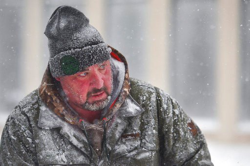 (Briana Sanchez/The Argus Leader via AP). James Schoenhard, with Schoenhard Lawn Care, plows sidewalks with his team downtown Saturday, April 14, in Sioux Falls, S.D.  A storm system stretching from the Gulf of Mexico to the Great Lakes has dumped a fo...