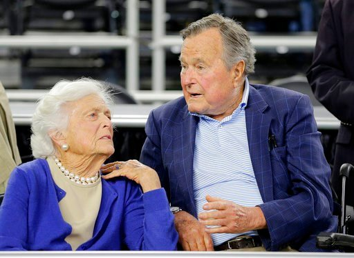 (AP Photo/David J. Phillip, File). FILE - In this March 29, 2015, file photo, former President George H.W. Bush and his wife Barbara Bush, left, speak before a college basketball regional final game between Gonzaga and Duke, in the NCAA basketball tour...