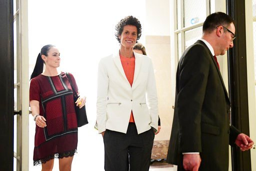 (AP Photo/Corey Perrine, Pool). Andrea Constand, center, chief accuser in the Bill Cosby trial, returns from lunch during the Bill Cosby sexual assault trial at the Montgomery County Courthouse, Friday, April 13, 2018, in Norristown, Pa.