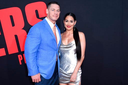 """(Photo by Richard Shotwell/Invision/AP). In this Tuesday, April 3 photo, John Cena, left, and Nikki Bella attend the LA Premiere of """"Blockers"""" at the Regency Village Theatre in Los Angeles."""