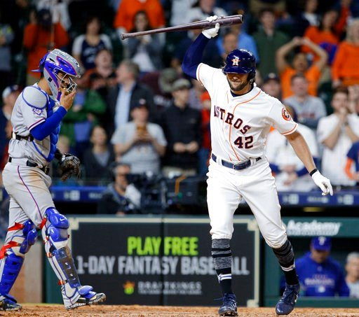 (AP Photo/Michael Wyke). Houston Astros' Jake Marisnick, right, throws down his bat in front of Texas Rangers catcher Robinson Chirinos after striking out on a full count with two on base to end the game with a score of 3-1 in the 10th inning of a base...