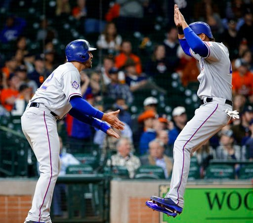 (AP Photo/Michael Wyke). Texas Rangers' Joey Gallo, left, and Ronald Guzman celebrate at the plate after scoring on a double by Robinson Chirinos, making the score 3-1, in the 10th inning of a baseball game against the Houston Astros, Sunday, April 15,...
