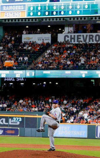 (AP Photo/Michael Wyke). Texas Rangers starting pitcher Bartolo Colon winds up to throw in the eighth inning against the Houston Astros during a baseball game Sunday, April 15, 2018, in Houston. Colon was on track for a no hitter before giving up a dou...