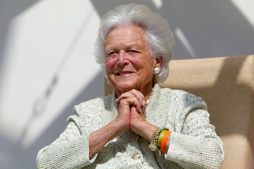 (AP Photo/Robert F. Bukaty, File). In a Thursday, Aug. 22, 2013, file photo, former first lady Barbara Bush listens to a patient's question during a visit to the Barbara Bush Children's Hospital at Maine Medical Center in Portland, Maine.