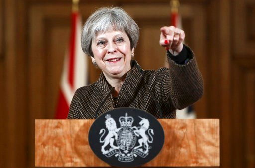 (Simon Dawson/Pool Photo via AP). Britain's Prime Minister Theresa May gestures during a press conference in 10 Downing Street, London, Saturday, April 14, 2018.