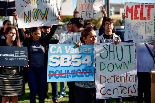 (Jeff Gritchen/The Orange County Register via AP, File). In this March 27, 2018, file photo, a group of sanctuary state supporters gather outside the Orange County Board of Supervisors meeting in Santa Ana, Calif.