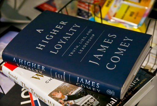 "(AP Photo/Bebeto Matthews). A copy of former FBI Director James Comey's new book, ""A Higher Loyalty: Truth, Lies and Leadership,"" is on display, Friday, April 13, 2018, in New York."