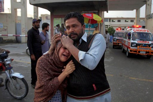 (AP Photo/Arshad Butt). A man comforts a Christian woman who lost her husband in a deadly shooting incident, outside a hospital in Quetta, Pakistan, Sunday, April 15, 2018. Pakistani police say gunmen opened fire on worshippers coming out of a church i...